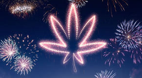 Night sky with fireworks shaped as a weed leaf.series Stock Photos