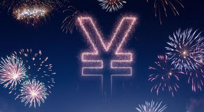 Night sky with fireworks shaped as a Yen symbol.series Stock Images