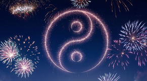 Night sky with fireworks shaped as a Ying Yang symbol.series Royalty Free Stock Photos