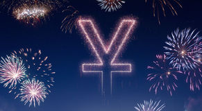 Night sky with fireworks shaped as a Yuan symbol.series. A dark night sky with a sparkling red firecracker in the shape of a Yuan symbol composed into.series Royalty Free Stock Photo