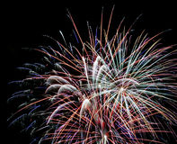 A Night Sky Full of Exploding Fireworks Stock Photography