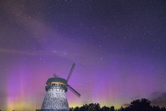 Night sky with light pollution. Night sky with a little bit of northern lights over windmill Stock Photography