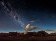 Night sky and milky way galaxy above Mount Bromo volcano. stock photos