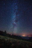 Night sky with Milky Way over the forest Stock Images