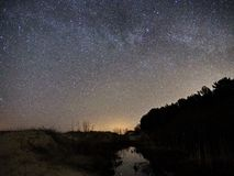 Night sky and milky way stars, Cassiopea Cygnus and Lyra constellation stock photography