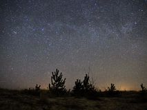 Night sky and milky way stars, Cassiopeia and andromeda constellation over sea stock photography