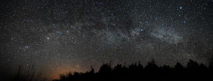 Night sky and milky way stars, Perseus Cassiopea Cygnus and Lyra constellation panorama. Sky observing after sunset stock photos