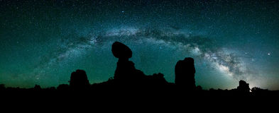 Night sky, Milkyway Galaxy, Balanced Rock. A panoramic view of the night sky over Utah's iconic Balanced Rock Stock Photo