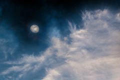 Night sky moon and clouds. Blue  sky at night with the moon and soft white clouds background Stock Photography