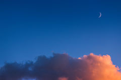 Night sky with moon and clouds Stock Image