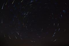Night sky with multicolored star tracks. Royalty Free Stock Photos