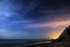 Night sky over the coastline royalty free stock photography