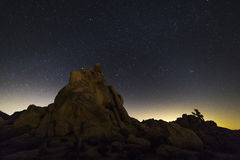 Night Sky Over Joshua Tree National Park, California. Rock formations silhouetted against a star-studded night sky - Joshua Tree National Park, California royalty free stock photos