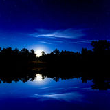Night sky over lake Stock Image