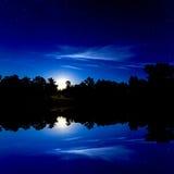 Night sky over lake Stock Image