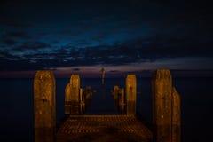 Night sky over pier Stock Photo