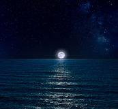 Night sky over sea with full moon Stock Photography