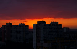Night sky with red sunset in the city Stock Photos