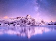 Night sky and reflection on the frozen lake. stock images
