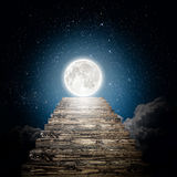 A night sky. Staircase rises to the moon in the night sky. Elements of this image furnished by NASA Royalty Free Stock Photo