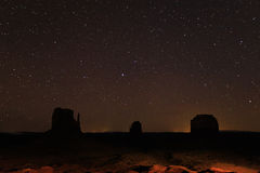 Night sky with stars above Monument Valley. Royalty Free Stock Image