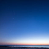 Night sky with stars on the beach. space view. Stock Photos