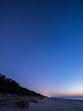 Night sky with stars on the beach. space view. Royalty Free Stock Photo