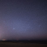 Night sky with stars on the beach. space view. Royalty Free Stock Photography
