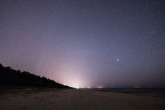Night sky with stars on the beach. space view. Stock Photography