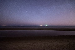 Night sky with stars on the beach. space view. Stock Image