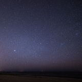 Night sky with stars on the beach. space view. Stock Photo
