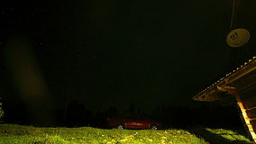 Night Sky With Stars. Car and country house by night, starry sky stock video footage