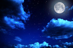Night sky with stars and full moon background. Backgrounds night sky with stars and moon and clouds. wood. Elements of this image furnished by NASA Royalty Free Stock Photo