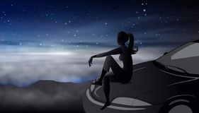 Night sky with stars girl silhouette on a car hood dreaming stock photo