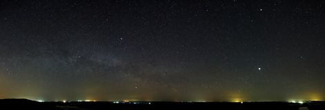 Night sky with the stars of the Milky Way galaxy. Panoramic view. Of the starry space Stock Photos