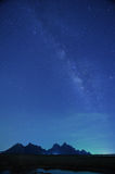 Night sky stars with milky way on mountain background Royalty Free Stock Images