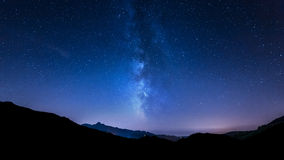 Night sky stars. Milky Way. Mountain background. Night sky panorama with moving stars and Milky way behind mountain Royalty Free Stock Photos