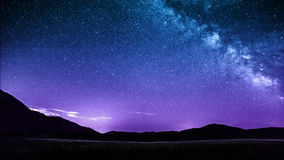 Night sky stars with milky way over mountains. Italy. Castelluccio di Norcia Stock Images