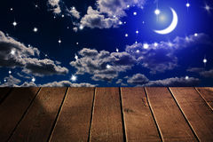 Night sky. With stars and moon, wooden planks Stock Photo