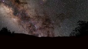 Night sky stars. With milky way on mountain background stock footage
