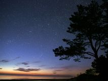 Night sky stars observing Perseus constellation over sea stock photography
