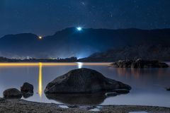 Night sky stars over mountain lake. Summer starry night. Nigth Landscape Royalty Free Stock Images