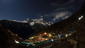 Night sky and stars passing by behind mountain Kongde Ri, Namche Royalty Free Stock Photography