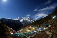 Night sky and stars passing by behind mountain Kongde Ri, Namche Royalty Free Stock Photo