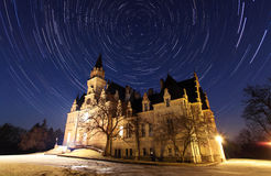 Night sky with stars trail and ancient castle. In Slovakia Stock Images