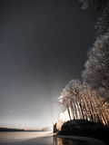 Night sky with stars in the winter night with trees. vintage Royalty Free Stock Images