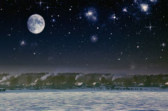 Night sky. In the village in the cold. Stock Photo