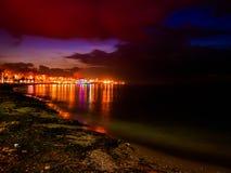 Night Skyline Of City On The Seaside Stock Photos