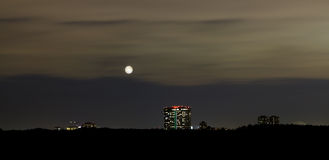 Night skyline with full moon Royalty Free Stock Photography