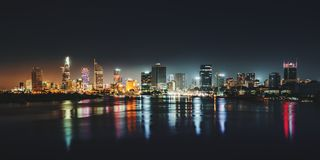 Night skyline panoramic view of Ho Chi Minh city. Front vi. Urban night skyline panoramic view of Ho Chi Minh city. Front view on colored skyscrapers in downtown stock image